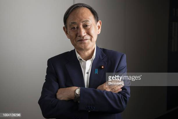 Yoshihide Suga Japan's chief cabinet secretary poses for a photograph in Tokyo Japan on Saturday July 21 2018 One of Japans top policy makers...