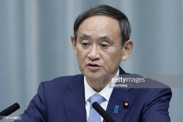 Yoshihide Suga Japan's chief cabinet secretary speaks during a news conference at the Prime Minister's official residence in Tokyo Japan on Wednesday...