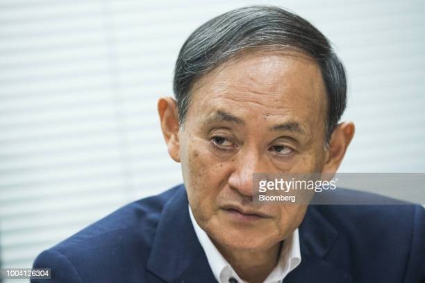 Yoshihide Suga Japan's chief cabinet secretary speaks during an interview in Tokyo Japan on Saturday July 21 2018 One of Japans top policy makers...