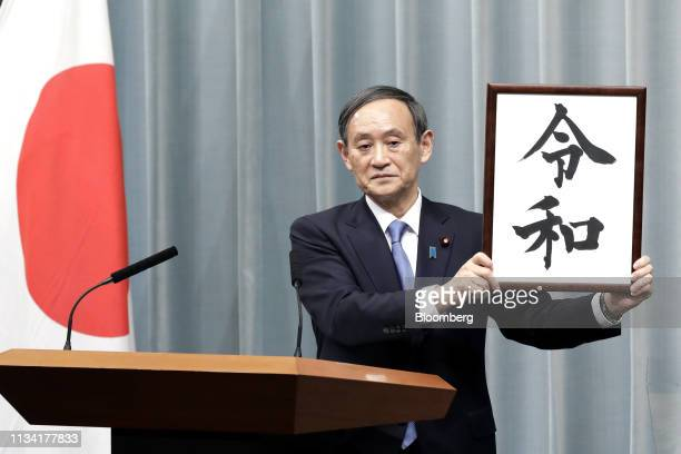 Yoshihide Suga Japan's chief cabinet secretary unveils the name of Japan's next imperial era Reiwa at the prime minister's official residence in...