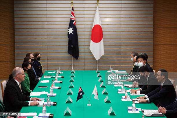 Yoshihide Suga, Japan's prime minister, front right, and Scott Morrison, Australia's prime minister, front left, attend the bilateral meeting at...