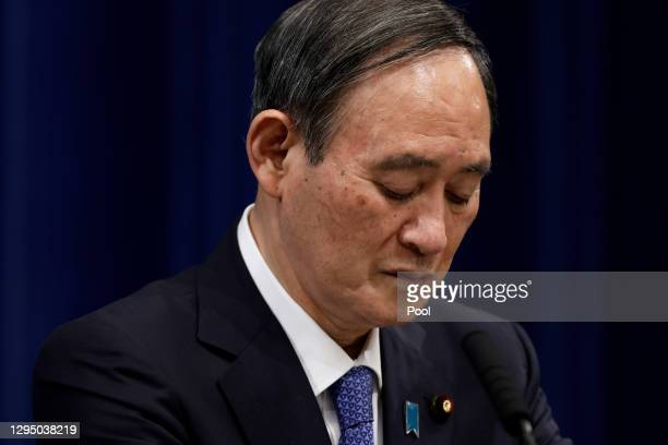 Yoshihide Suga, Japan's prime minister, pauses during a news conference at the prime minister's official residence on January 07, 2021 in Tokyo,...