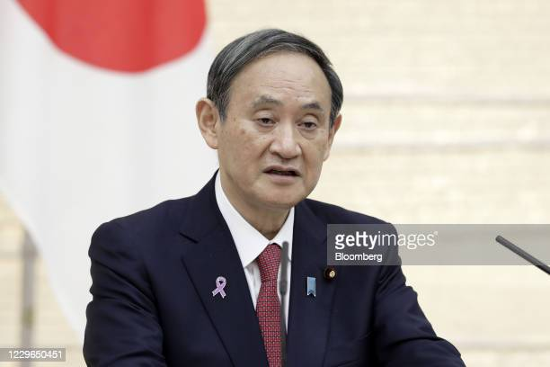 Yoshihide Suga, Japan's prime minister, speaks during a joint news conference with Scott Morrison, Australia's prime minister, not pictured, at...