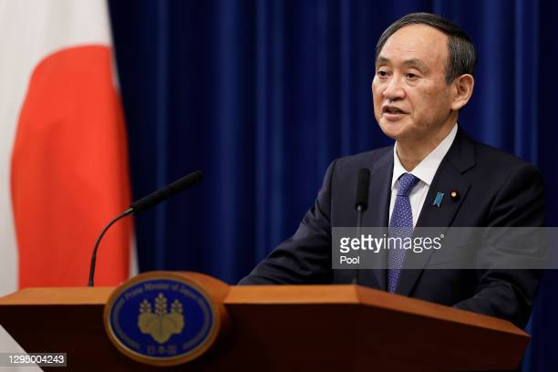 Yoshihide Suga, Japan's prime minister, speaks during a news conference at the prime minister's official residence on January 07, 2021 in Tokyo,...