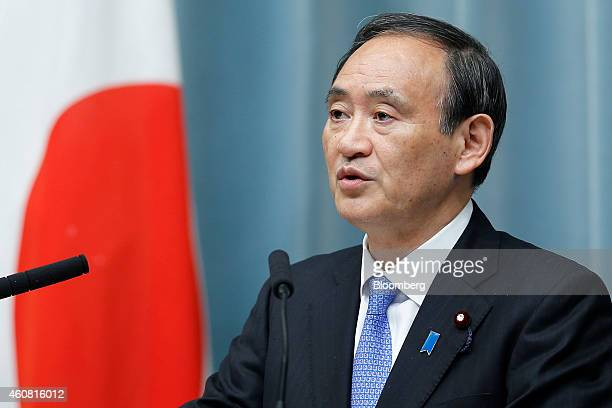 Yoshihide Suga Japan's reappointed chief cabinet secretary speaks during a news conference announcing Japan's new cabinet members at the prime...
