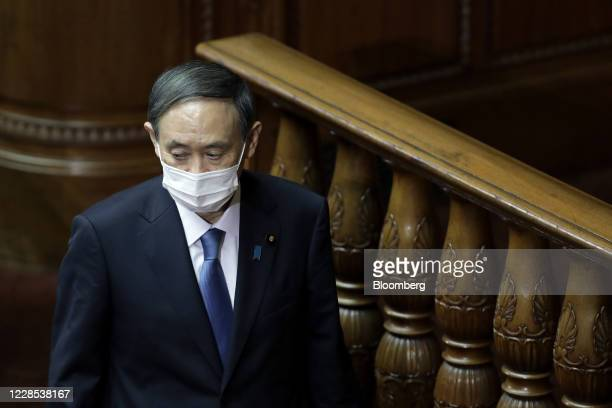 Yoshihide Suga, president of the Liberal Democratic Party , walks back to his seat after casting his ballot for the nomination of Japan's prime...