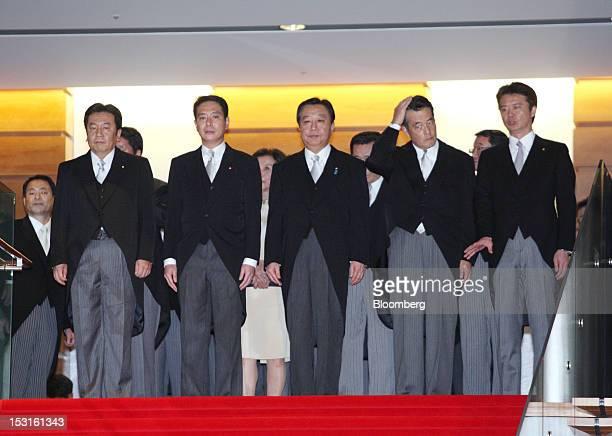 Yoshihiko Noda Japan's prime minister center leads cabinet members Yukio Edano economy trade and industry minister from left to right Seiji Maehara...