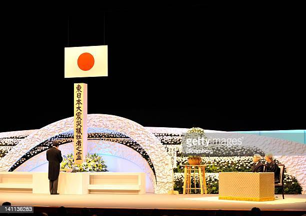 Yoshihiko Noda Japan's prime minister left delivers remarks as Emperor Akihito second from right and Empress Michiko listen during a memorial service...