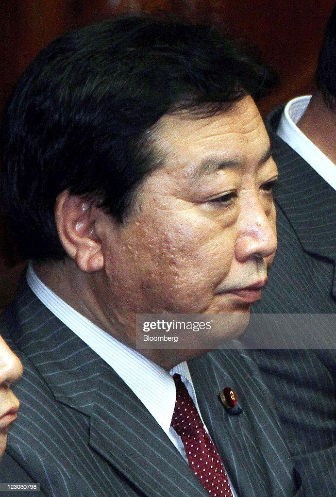 Yoshihiko Noda, president of the Democratic Party of Japan (DPJ) and Japan's newly named prime minister, attends a meeting at the lower house of parliament in Tokyo, Japan, on Tuesday, Aug. 30, 2011. Noda becomes Japan's sixth leader in five years, seeking a consensus to raise taxes to pay for rebuilding from the March earthquake and nuclear disaster and reduce the world's largest debt. Photographer: Haruyoshi Yamaguchi/Bloomberg via Getty Images