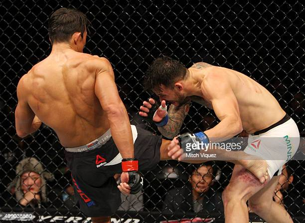Yoshihiro Akiyama of Japan kicks Alberto Mina of Brazil in their welterweight bout during the UFC Fight Night at the Olympic Park Gymnastics Arena on...