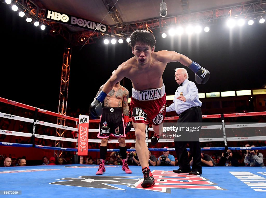 Yoshihiro Kamegai loses his balance as he is pushed by Miguel Cotto in a 12 round unanimous decision Cotto victory, during the WBO Junior Middleweight title fight at StubHub Center on August 26, 2017 in Carson, California.