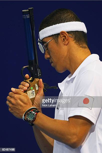 Yoshihiro Murakami of Japan gathers his thoughts before firing in the Men's Shooting 10m Air Pistol held at the Fencing Hall during Day 13 of the...