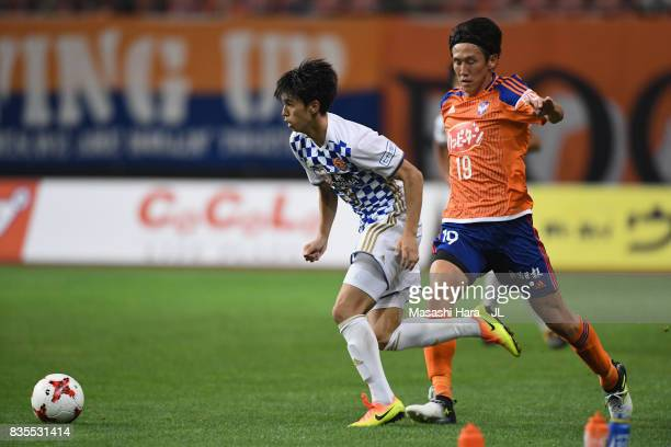 Yoshihiro Nakano of Vegalta Sendai and Kisho Yano of Albirex Niigata compete for the ball during the JLeague J1 match between Albirex Niigata and...