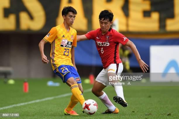 Yoshihiro Nakano of Vegalta Sendai and Wataru Endo of Urawa Red Diamonds compete for the ball during the JLeague J1 match between Vegalta Sendai and...