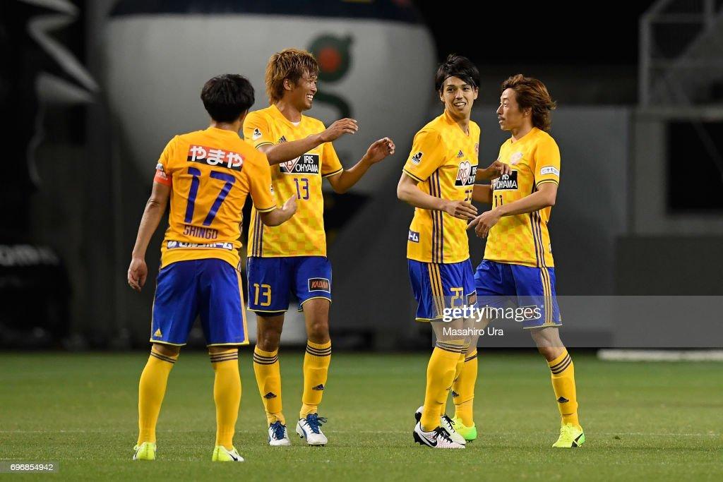 Yoshihiro Nakano (2nd R) of Vegalta Sendai celebrates scoring his side's first goal with his team mates during the J.League J1 match between Sagan Tosu and Vegalta Sendai at Best Amenity Stadium on June 17, 2017 in Tosu, Saga, Japan.