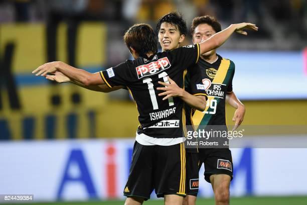 Yoshihiro Nakano of Vegalta Sendai celebrates scoring his side's first goal with his team mates during the JLeague J1 match between Vegalta Sendai...