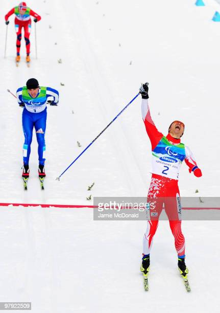 Yoshihiro Nitta of Japan celebrates as he crosses the line ahead of Kirii Mikhaylov of Russia to win gold in the Men's 1km Standing CrossCountry...