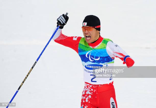 Yoshihiro Nitta of Japan celebrates as he crosses the line to win gold in the Men's 1km Standing CrossCountry Sprint Final during Day 10 of the 2010...