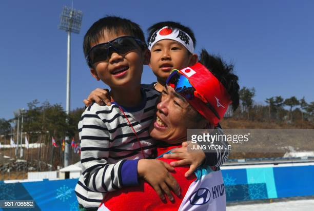 Yoshihiro Nitta of Japan celebrates his 2nd place with his children after a victory ceremony of the men's 15km sprint classic standing crosscountry...