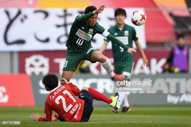 Yoshihiro Shoji of FC Gifu is tackled by Yoshinari Takagi of FC Gifu during the JLeague J2 match between Nagoya Grampus and FC Gifu at Toyota Stadium...