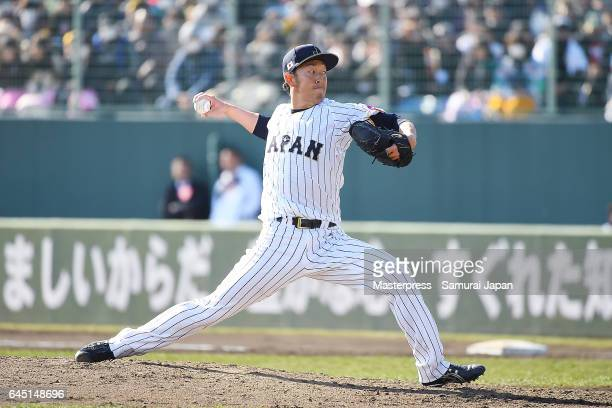 Yoshihisa Hirano of Samurai Japan pitches in the seventh inning during the SAMURAI JAPAN Friendly Opening Match between SAMURAI JAPAN and Fukuoka...