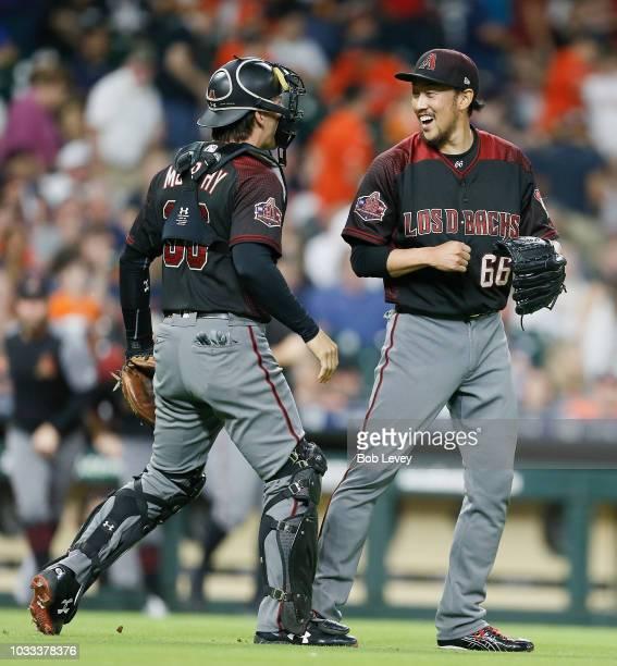 Yoshihisa Hirano of the Arizona Diamondbacks celebrates with John Ryan Murphy after defeating the Houston Astros 42 at Minute Maid Park on September...
