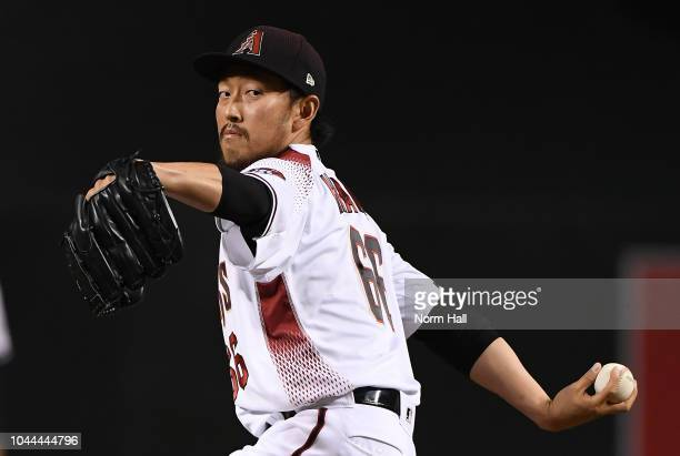 Yoshihisa Hirano of the Arizona Diamondbacks delivers a ninth inning warm up pitch against the Los Angeles Dodgers at Chase Field on September 24...