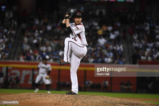 Yoshihisa Hirano of the Arizona Diamondbacks delivers a ninth inning pitch against the Los Angeles Dodgers at Chase Field on September 24 2018 in...