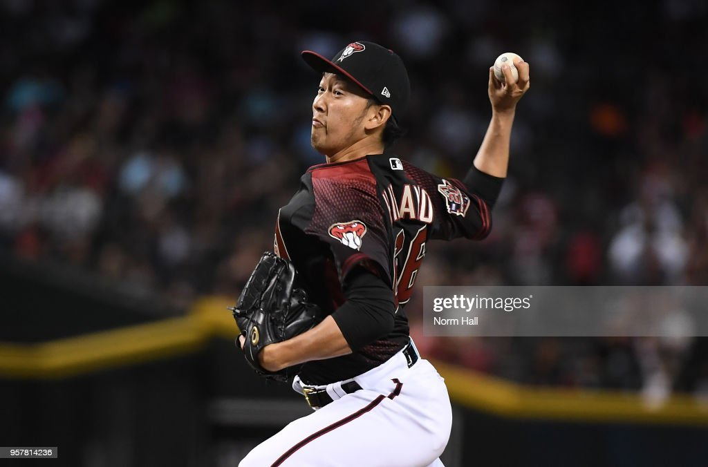 Yoshihisa Hirano #66 of the Arizona Diamondbacks delivers a pitch against the Washington Nationals during the eighth inning at Chase Field on May 12, 2018 in Phoenix, Arizona.