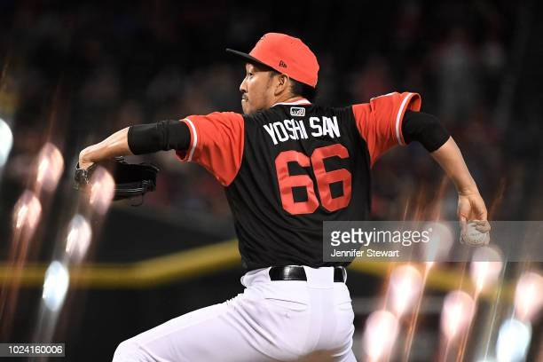 Yoshihisa Hirano of the Arizona Diamondbacks delivers a pitch in the ninth inning of the MLB game against the Seattle Mariners at Chase Field on...