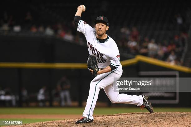 Yoshihisa Hirano of the Arizona Diamondbacks delivers a pitch in the tenth inning of the MLB game against the Atlanta Braves at Chase Field on...