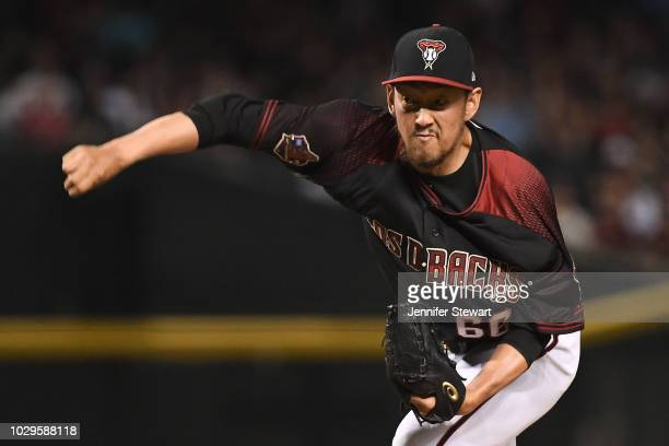 Yoshihisa Hirano of the Arizona Diamondbacks delivers a pitch in the ninth inning of the MLB game against the Atlanta Braves at Chase Field on...