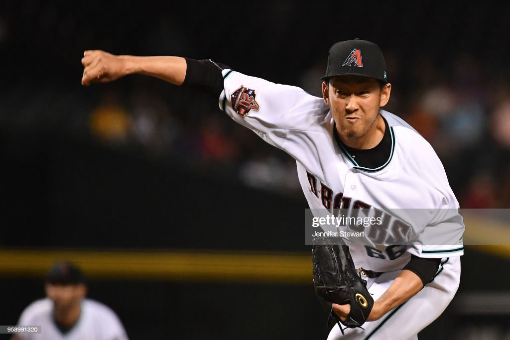 Yoshihisa Hirano #66 of the Arizona Diamondbacks delivers a pitch in the seventh inning of the MLB game against the Milwaukee Brewers at Chase Field on May 15, 2018 in Phoenix, Arizona.