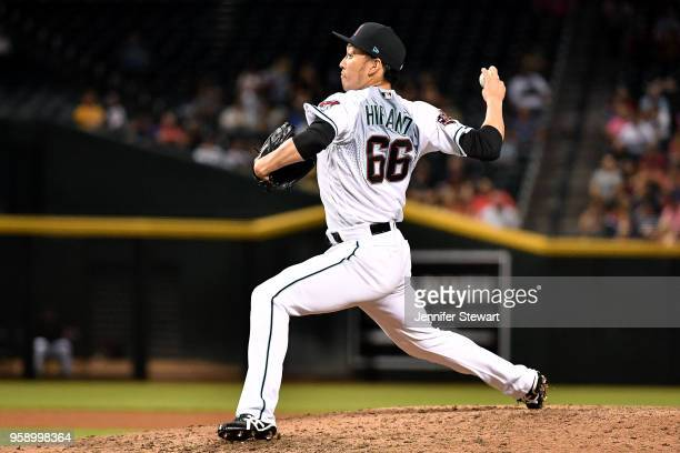Yoshihisa Hirano of the Arizona Diamondbacks delivers a pitch in the seventh inning of the MLB game against the Milwaukee Brewers at Chase Field on...