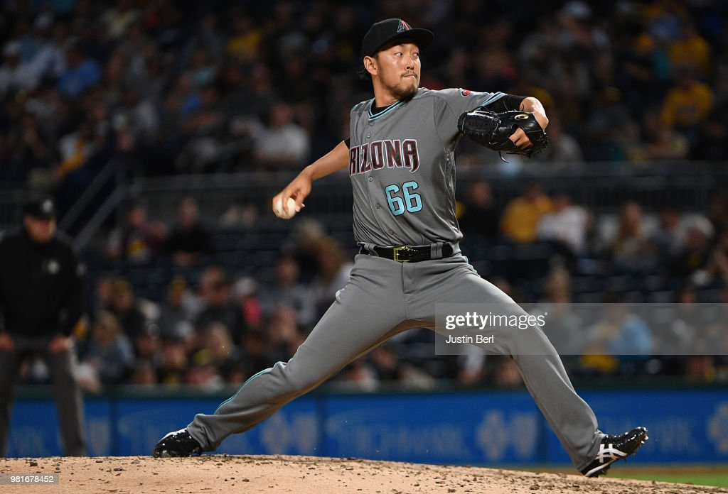 Yoshihisa Hirano #66 of the Arizona Diamondbacks delivers a pitch in the eighth inning during the game against the Pittsburgh Pirates at PNC Park on June 22, 2018 in Pittsburgh, Pennsylvania.