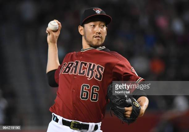 Yoshihisa Hirano of the Arizona Diamondbacks delivers a tenth inning pitch against the San Diego Padres at Chase Field on July 8 2018 in Phoenix...