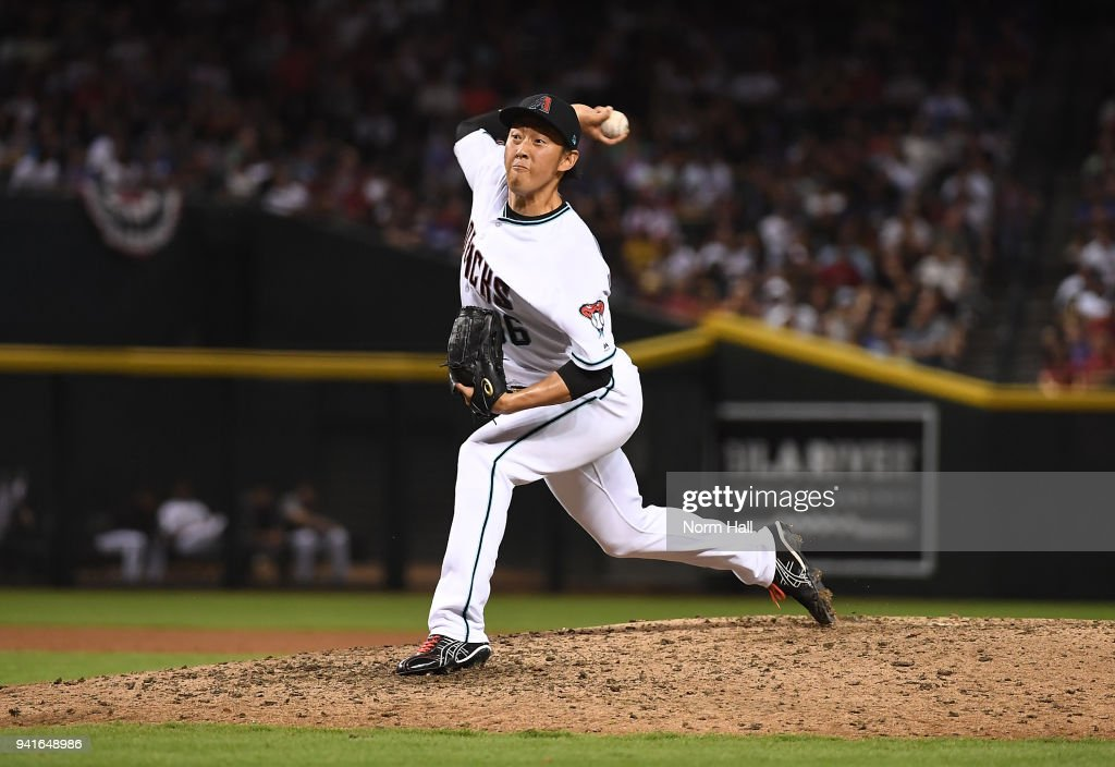 Yoshihisa Hirano #66 of the Arizona Diamondbacks delivers an eighth inning pitch against the Los Angeles Dodgers at Chase Field on April 3, 2018 in Phoenix, Arizona.