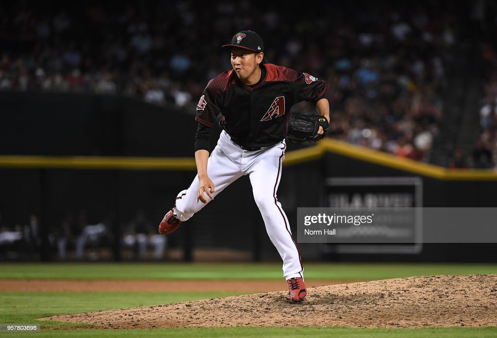Yoshihisa Hirano #66 of the Arizona Diamondbacks follows through on delivering a pitch against the Washington Nationals during the eighth inning at Chase Field on May 12, 2018 in Phoenix, Arizona.