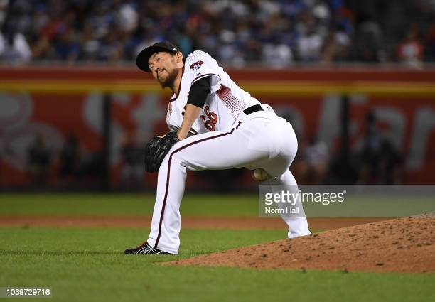 Yoshihisa Hirano of the Arizona Diamondbacks gets ready to take the mound during the ninth inning against the Los Angeles Dodgers at Chase Field on...