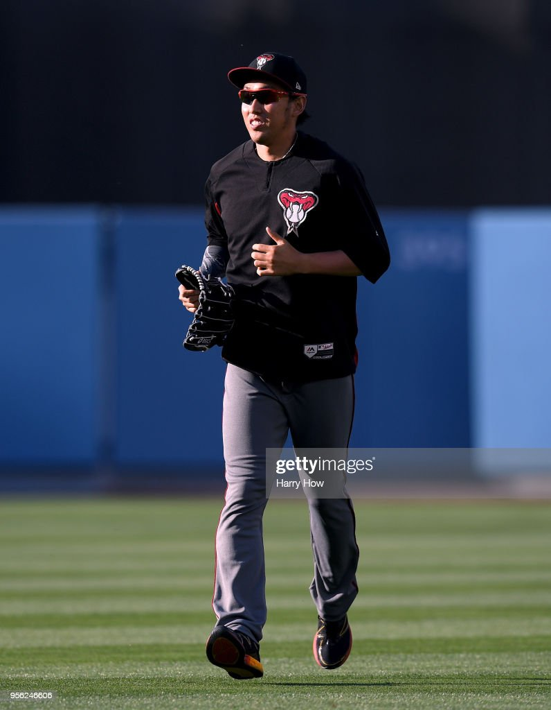 Yoshihisa Hirano #66 of the Arizona Diamondbacks makes his way to the dugout before the game against the Los Angeles Dodgers at Dodger Stadium on May 8, 2018 in Los Angeles, California.