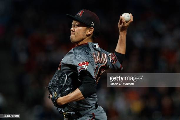 Yoshihisa Hirano of the Arizona Diamondbacks pitches against the San Francisco Giants during the eighth inning at ATT Park on April 9 2018 in San...