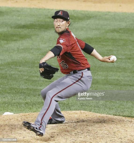 Yoshihisa Hirano of the Arizona Diamondbacks pitches during the ninth inning of a game against the Colorado Rockies on Sept 12 in Denver Colorado...