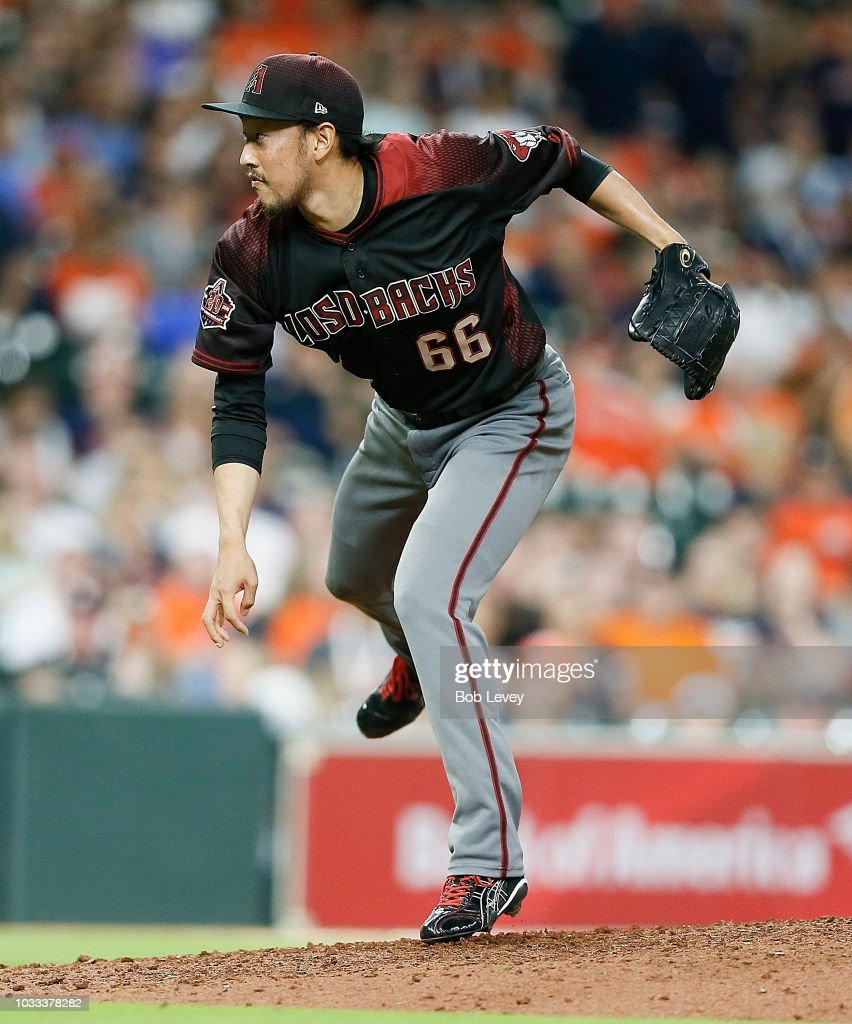 Yoshihisa Hirano #66 of the Arizona Diamondbacks pitches in the ninth inning to get the save as they beat the Houston Astros 4-2 at Minute Maid Park on September 14, 2018 in Houston, Texas.