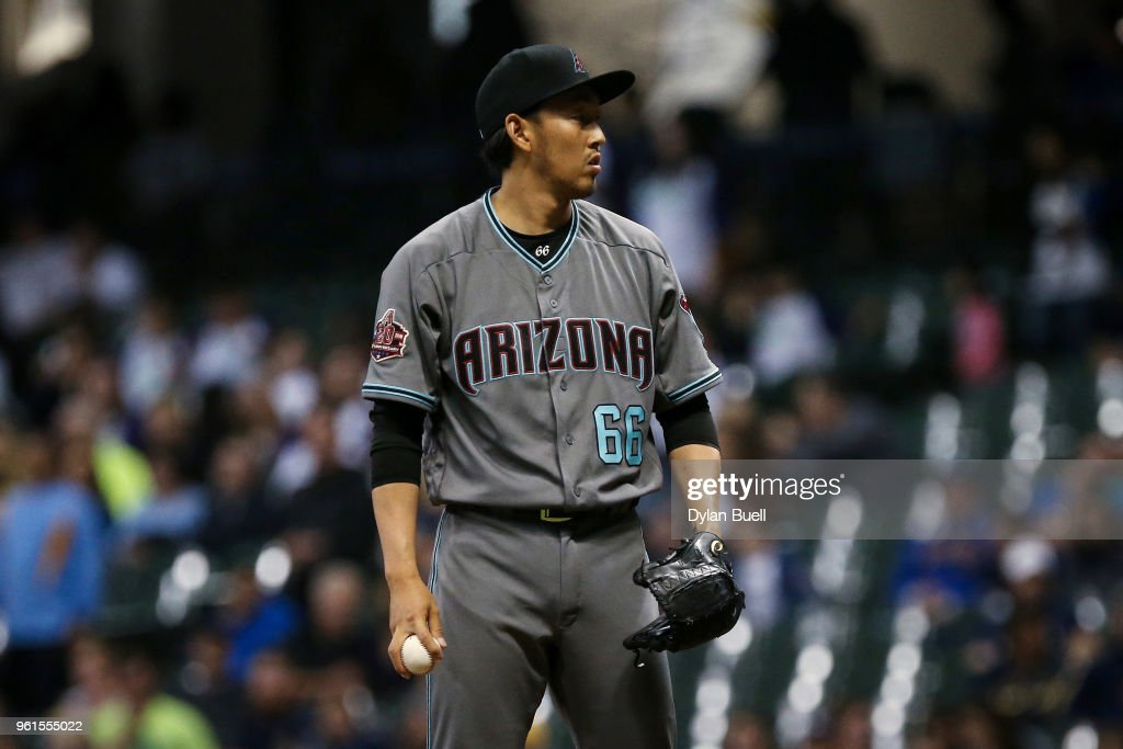 Yoshihisa Hirano #66 of the Arizona Diamondbacks pitches in the seventh inning against the Milwaukee Brewers at Miller Park on May 22, 2018 in Milwaukee, Wisconsin.
