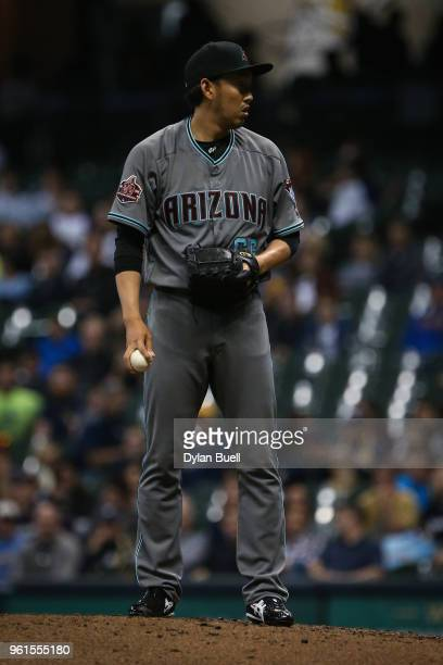 Yoshihisa Hirano of the Arizona Diamondbacks pitches in the seventh inning against the Milwaukee Brewers at Miller Park on May 22 2018 in Milwaukee...