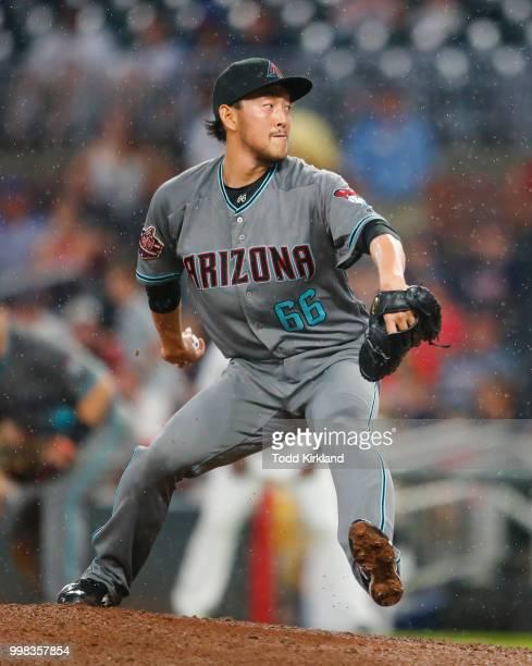 Yoshihisa Hirano of the Arizona Diamondbacks pitches in the seventh inning of an MLB game against the Atlanta Braves at SunTrust Park on July 13 2018...