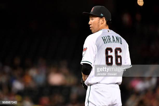 Yoshihisa Hirano of the Arizona Diamondbacks prepares to deliver a pitch in the seventh inning of the MLB game against the Milwaukee Brewers at Chase...