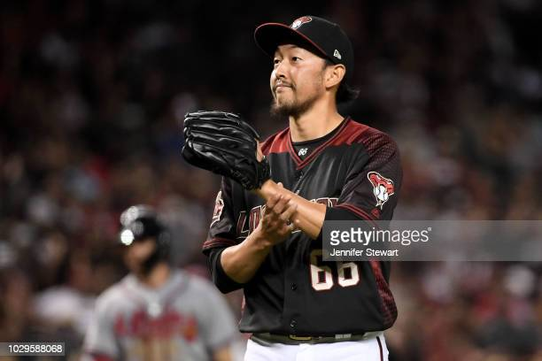 Yoshihisa Hirano of the Arizona Diamondbacks reacts during the ninth inning of the MLB game against the Atlanta Braves at Chase Field on September 8...