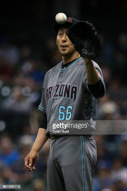 Yoshihisa Hirano of the Arizona Diamondbacks receives the ball in the seventh inning against the Milwaukee Brewers at Miller Park on May 22 2018 in...