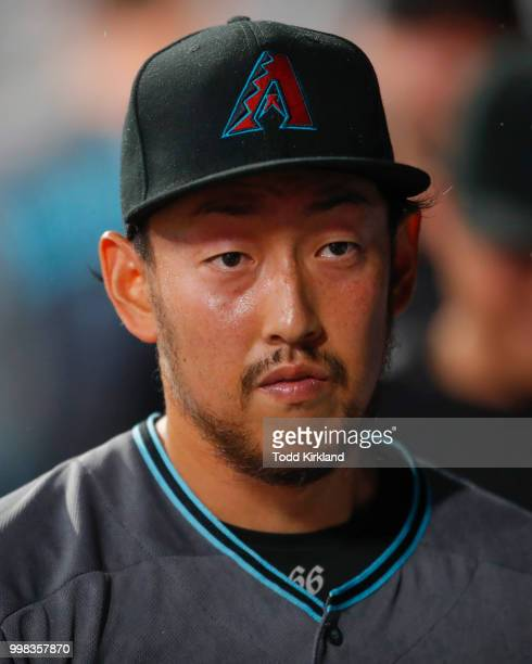 Yoshihisa Hirano of the Arizona Diamondbacks returns to the dugout at the end of the seventh inning of an MLB game against the Atlanta Braves at...